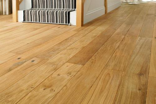 A front room in a home with new, quality solid oak flooring installed.