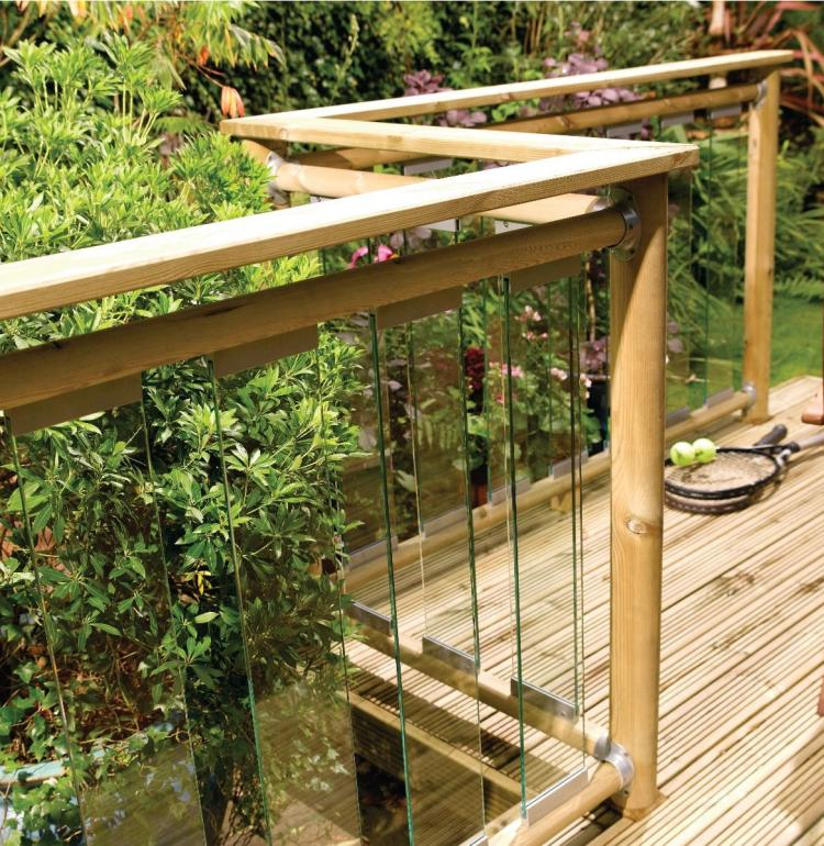 A picture of outdoor decking boasting polished, see-through glass and wood rails and posts.