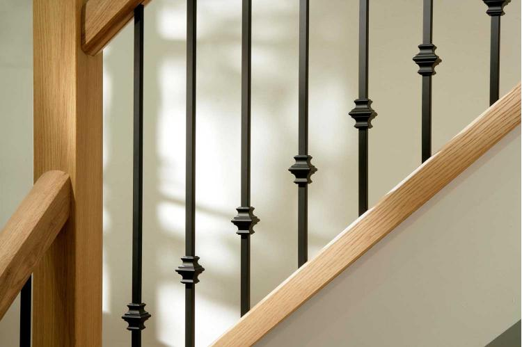 Black metal stair spindles in a room