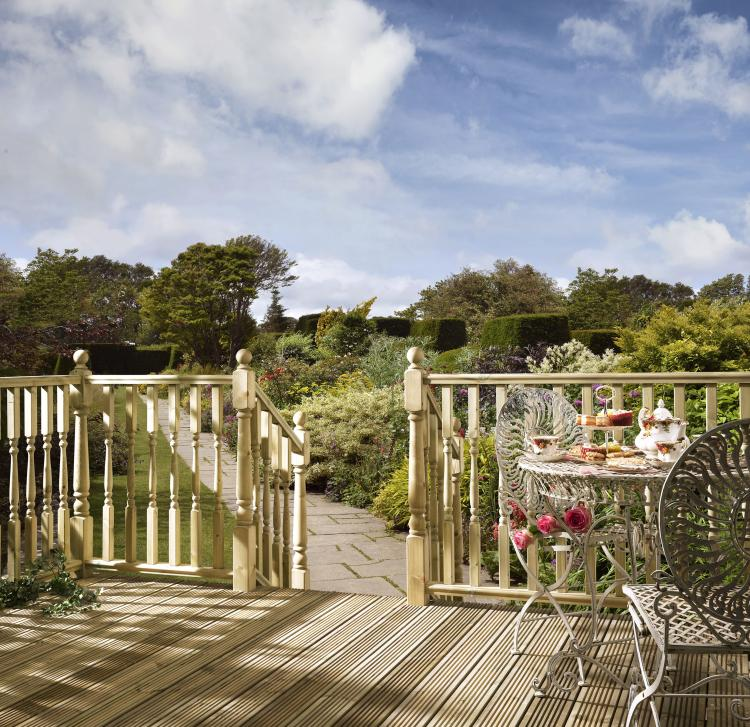 A picture of outdoor decking in the summer.