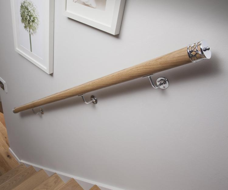 The Axxys wall mounted handrail kit fixed to a white wall in someones cottage home.