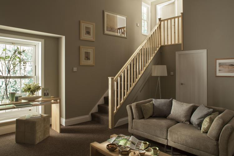 A picture of the Plain Square range of stair parts we stock here at Blueprint Joinery in someones living room.