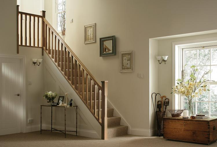 Stop Chamfered Oak timber stairparts in a home with brown carpet and cream walls.