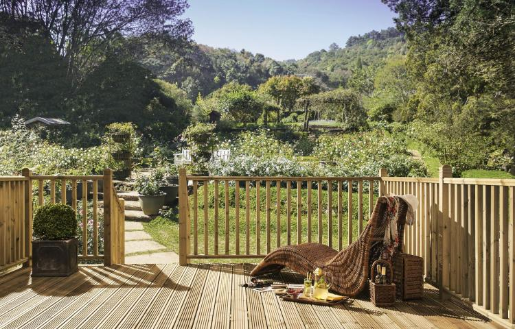 A picture of a garden on a sunny day with Square Decking Balustrade