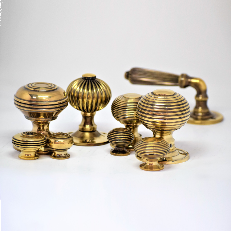 Brass door handles and knobs manufactured by Spira Brass.