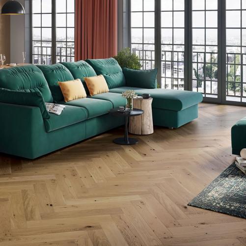 A modern and vibrant looking living room with Herringbone Toffee Oak Engineered Flooring installed.