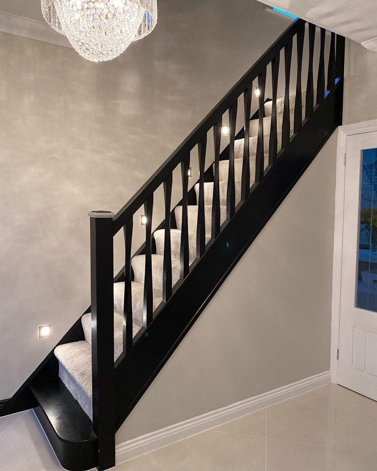 Black stair parts including black spindles, newel posts, handrail and base rail.