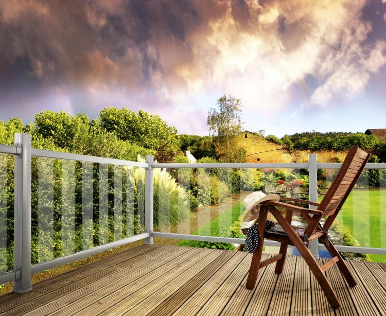 A picture of a garden on a sunny day with Modern Metal and Glass Decking Balustrade